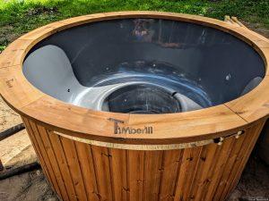 Fiberglass outdoor hot tub with external heater 29