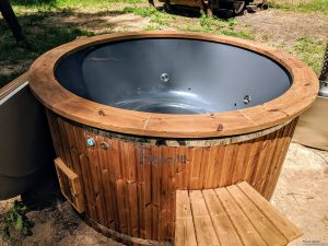Fiberglass outdoor hot tub with external heater 31