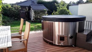 Outdoor whirlpool hot tub with Smart pellet stove