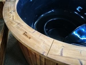 Outdoor hot tub with wood fired external burner black fiberglass thermo wood 10