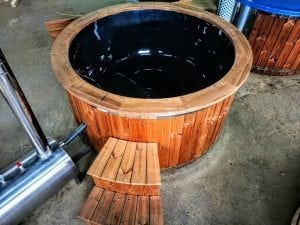 Outdoor hot tub with wood fired external burner black fiberglass thermo wood 4