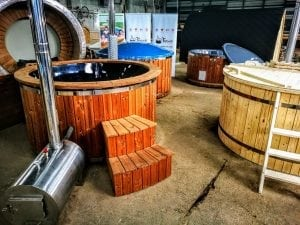 Outdoor hot tub with wood fired external burner black fiberglass thermo wood 9