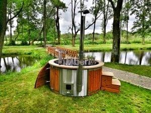 Wellness fiberglasshot tub with complete wood decoration 1
