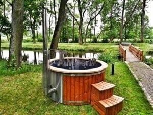 Wellness fiberglasshot tub with complete wood decoration 3