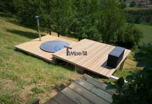 Wellness hot tub with external wood burner integrated terrace