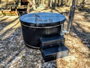 Black fiberglass lined hot tub with integrated burner Wellness Scandinavian 28