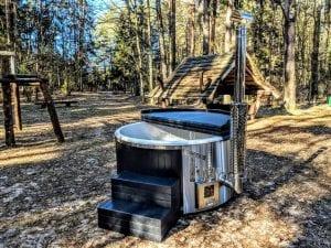 Black fiberglass lined hot tub with integrated burner Wellness Scandinavian 35