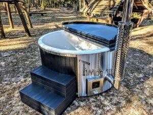 Black fiberglass lined hot tub with integrated burner Wellness Scandinavian 45