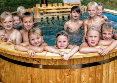 Round wood powered hot tub