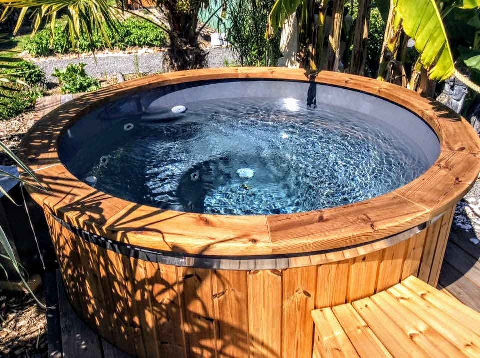Wooden hot tub full of water