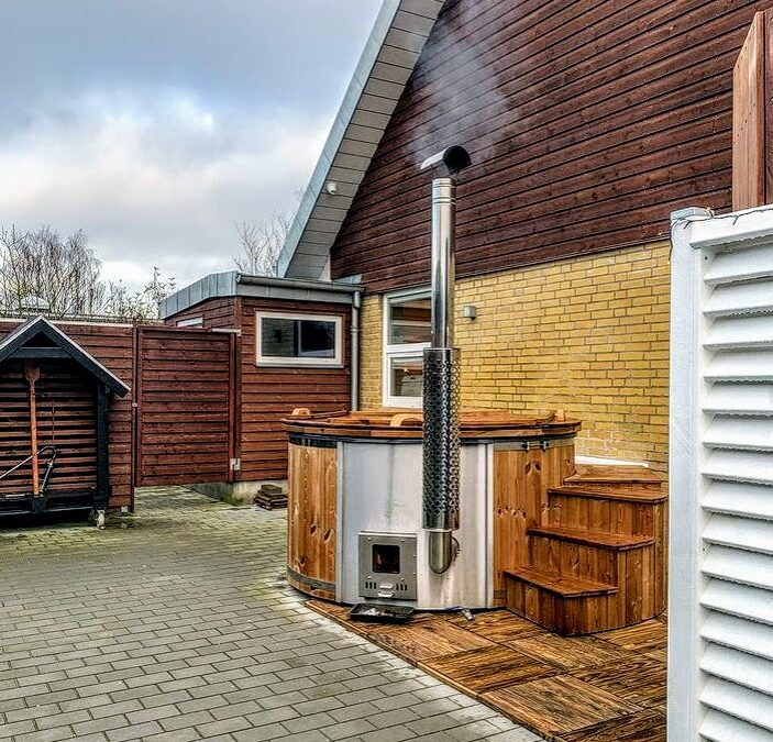 Wood burning hot tub with the integrated heater